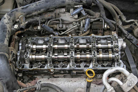 Car Engine With Open Camshafts in Garage