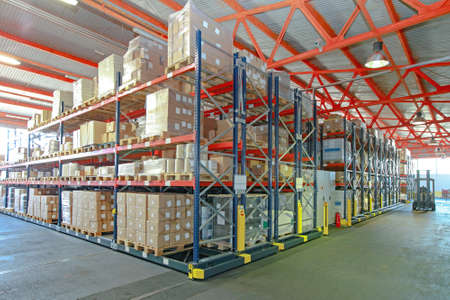 Mobile Aisle Racking System in Distribution Warehouse Stock Photo