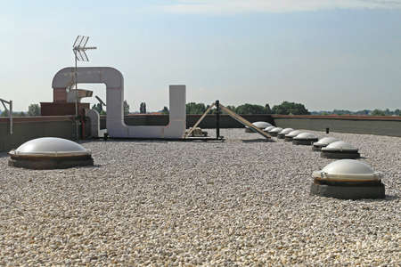 Flat Roof With Gravel and Skylight Windoows Stock Photo