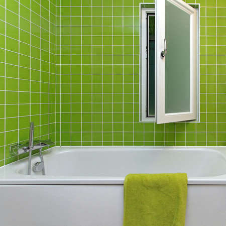 Modern Bathroom with Bathtub and Green Tiles Stock Photo - 86389549
