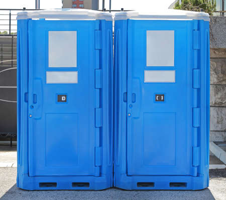 Two Blue Plastic Mobile Toilet Cabins Stock Photo