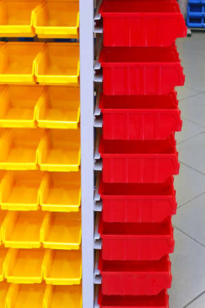 Red and Yellow Plastic Racks for Parts Storage Stock Photo