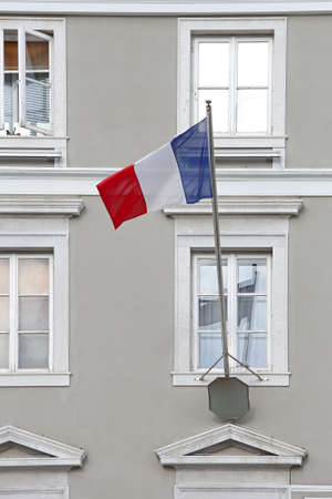 Flag of France Tricolour at Window Pole Stock Photo