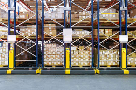 High Density Storage Shelving System in Warehouse Stock Photo