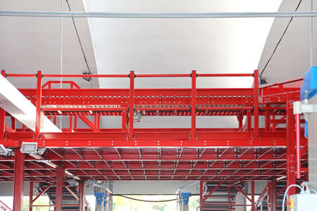 Elevated Shipping Conveyor in Distribution Warehouse Stock Photo