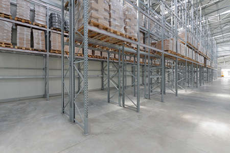 Pallets With Goods at Shelves in Distribution Warehouse