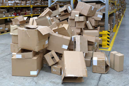 Big Pile of Empty Boxes in Warehouse