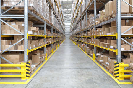 Long Aisle With Shelves in Fulfillment Warehouse Stock Photo