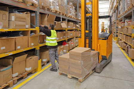 Worker Order Picking in Fulfillment Warehouse