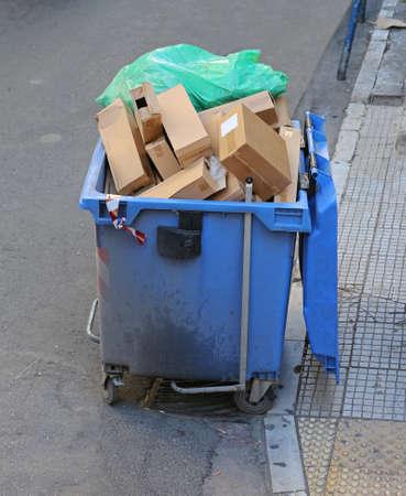 Overflow of Trash in Garbage Container at Street 版權商用圖片