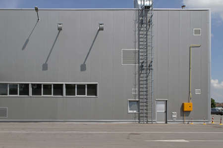 Distribution Warehouse Building Exterior With Safety Ladder Stock Photo
