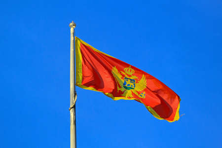 Montenegro Flag at Pole Flying at Wind