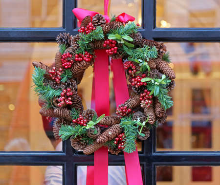 Christmas Wreath With Pinecones Decoration at Window for Holiday
