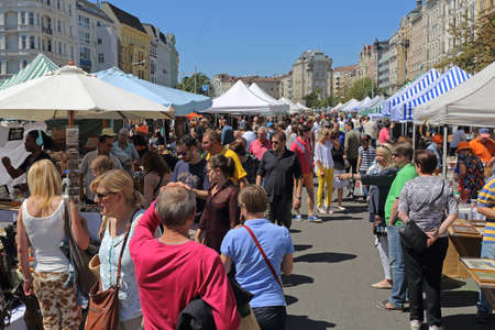 Vienna, Austria - July 11, 2015: People Shopping at Naschmarkt Flea Market Saturday Summer in Vienna, Austria.