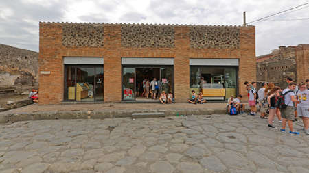 Pompei, Italy - June 25, 2014: Bunch of Tourists at Autogrill Restaurant in Ancient Roman Ruins Near Naples, Italy.