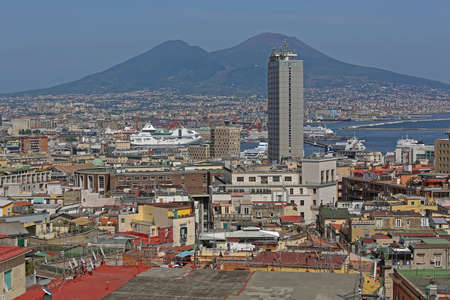 Naples, Italy - June 23, 2014: Cityscape of Naples With Mount Vesuvius in Background in Napoli, Italy.