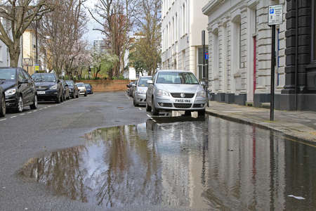 London, United Kingdom - April 03, 2010:  Big Pot of Water at Flooded Street After Heavy Rain in London, UK. Editorial