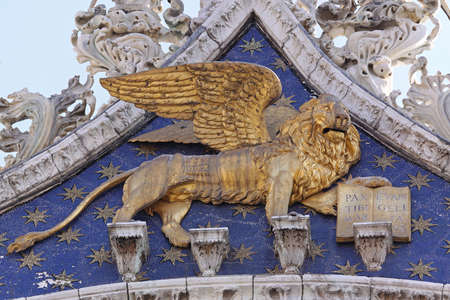 Venice, Italy - September 23, 2009: Gold Lion of Saint Mark With Wings at Church in Venezia, Italy.