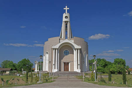 Donji Stroj, Montenegro - April 18, 2011: New Albanian Catholic Church Building in Donji Stroj, Montenegro. Редакционное