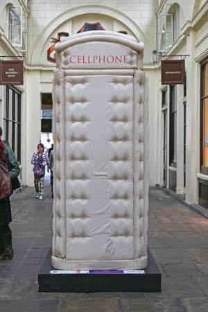London, United Kingdom - June 23, 2012: Telephone Booth Padded Cell Phone Box From Bert Gilbert at Covent Garden in London, UK.
