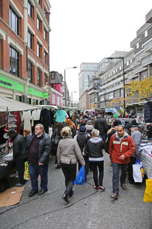 LONDON, UNITED KINGDOM - NOVEMBER 24, 2013: People Shopping at Petticoat Lane Market With Clothing Stalls at Sunday in London, United Kingdom.