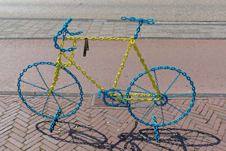 Decorative Bicycle Shape Made From Chains Stock Photo