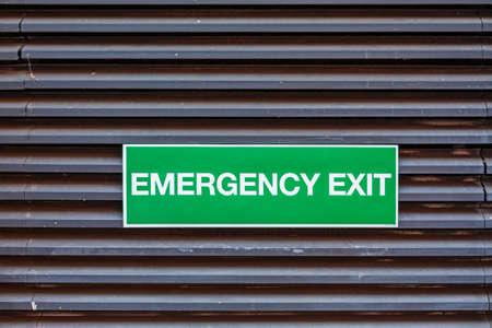 Green Sign Emergency Exit at Building Door