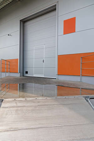 Loading Dock With Metal Ramp at Warehouse