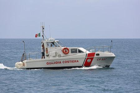 AMALFI COAST, ITALY - JUNE 28, 2014: Coast Guard Boat Patrolling at Tyrrhenian Sea in Amalfi Coast, Italy.