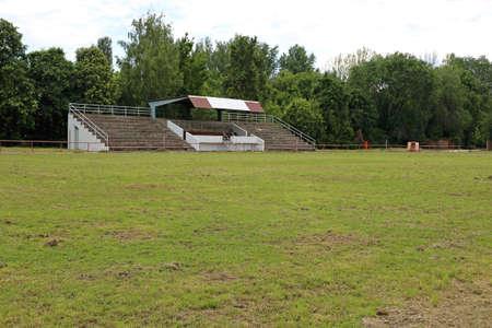 Empty Hippodrome Stadium Stands and Green Grass