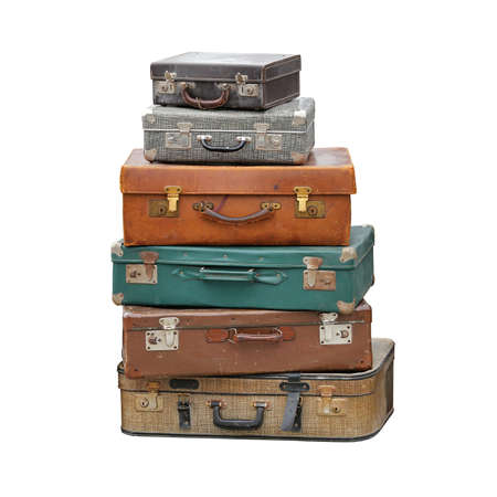 Grande mucchio di valigia vintage retrò viaggio bagagli isolato