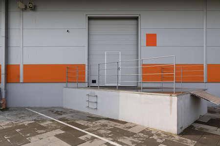 Loading Cargo Door at Distribution Warehouse Building