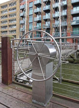 Steering Wheel for Movable Suspension Draw Bridge Over Canal Reklamní fotografie