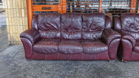 Rejected Old Leather Sofa in Front of Shop Stok Fotoğraf