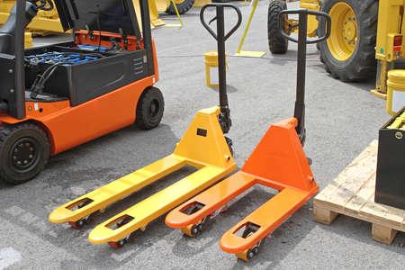 Two Pump Trucks Pallet Jacks Forklifts