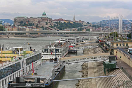 Budapest, Hungary - July 13, 2015: Moored Cruise Ships at Danube River Pontoons in Budapest, Hungary.