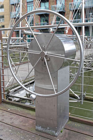 Steering Wheel Control for Movable Suspension Bridge Over Canal