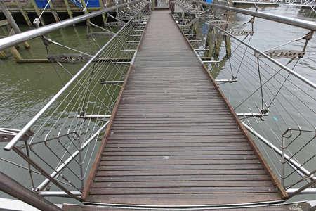 Suspension Bridge For Pedestrians Over Canal Water