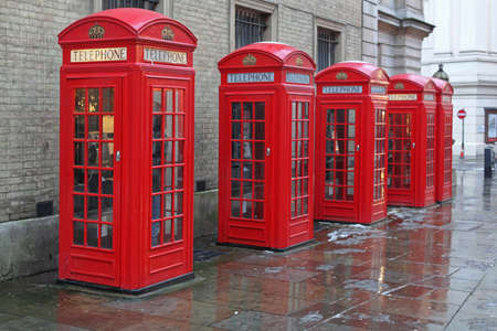 Five Red Telephone Booths at West End in London Stock fotó