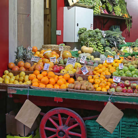Fruits and Vegetables in Cart at Farmers Market Stock Photo