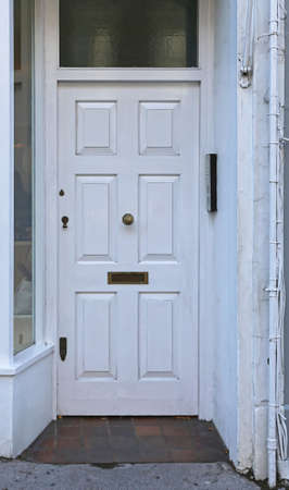 Old Wooden White Door With Mail Slot in London Stock Photo