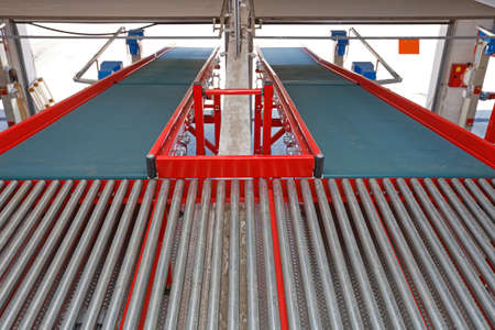 Two Conveyor Belts at Ramp for Cargo Shipping in Distribution Warehouse
