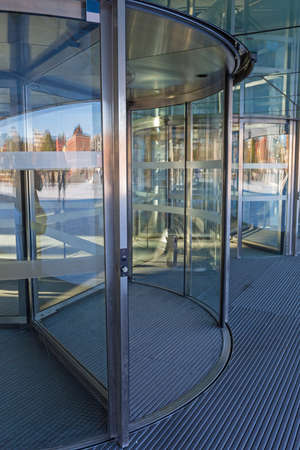 Automatic Revolving Doors at Modern Building Entrance