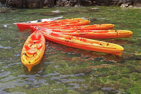 Sea Touring Orange Kayaks at Mooring Line