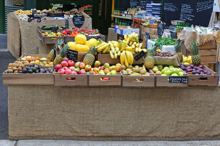 Big Selection of Fruits in Crates at Farmers Market Stall