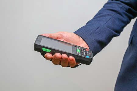 Man Holding Handheld Barcode Reader Scanner Mobile Computer