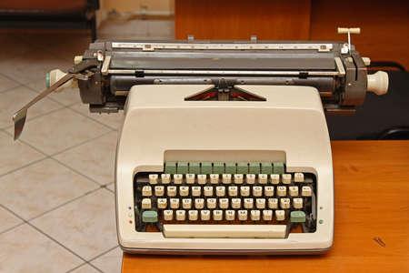 Mechanical Typewriter Machine at Desk in Retro Office
