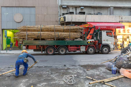 Kowloon, Hong Kong - April 22, 2017: Bamboo Scaffoldings at Truck in Mong Kok, Hong Kong, China. Editoriali