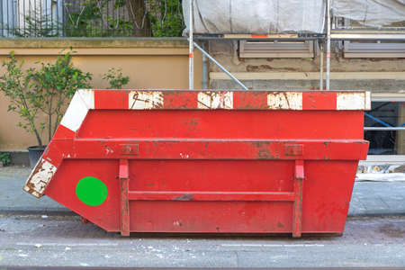 Big Red Skip Container at Construction Site in City