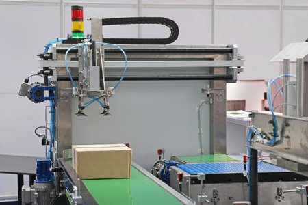 Handling Package at Automated Production Line in Factory